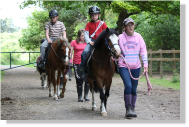 Image of children going out for a hack on the trail at pembrey park riding centre carmarthenshire